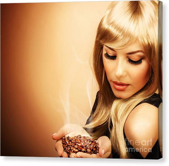 Beautiful Woman Holding Coffee Bean Canvas Print by Anna Om