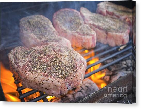Ribeye Canvas Print - Beef Ribeye Steaks Grilling Over Hot Fire by Andre Babiak