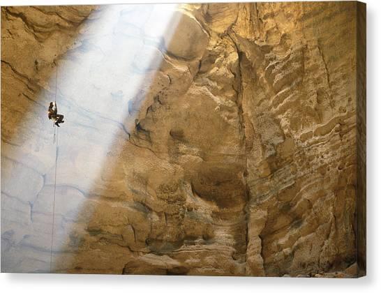 Spelunking Canvas Print - Ben Caddell Descends Majlis Al Jinn by Stephen Alvarez