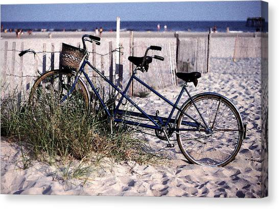Bicycle Built For Two On A Beach Canvas Print by Ercole Gaudioso