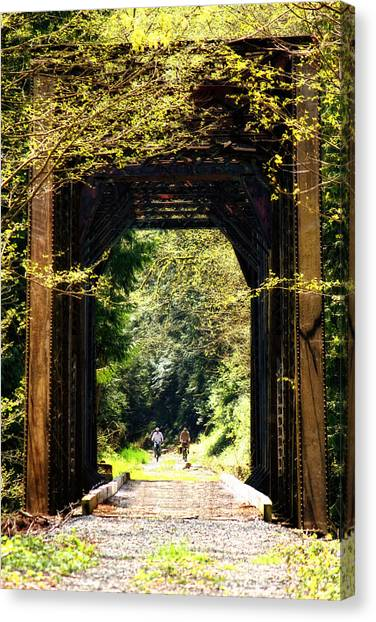 Bicycling Across Old Train Bridge Canvas Print
