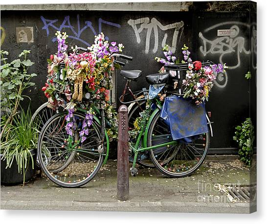 Bikes As Art Canvas Print by Ed Rooney