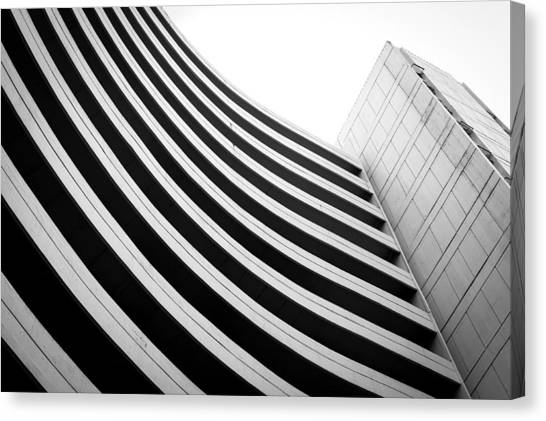 Black And White Building Curve Shape  Canvas Print by Kittipan Boonsopit
