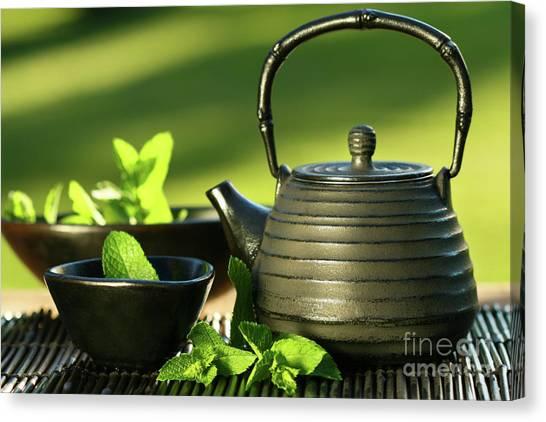 Sweet Tea Canvas Print - Black Asian Teapot With Mint Tea by Sandra Cunningham