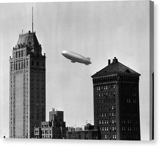 Blimp Over City Canvas Print by George Marks