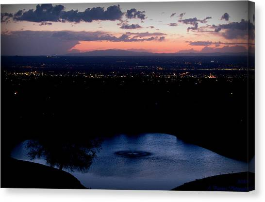 Blue Waters And City Lights Canvas Print by Aaron Burrows