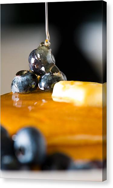 Blueberry Butter Pancake With Honey Maple Sirup Flowing Down Canvas Print