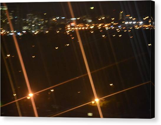Blurred City Nights Canvas Print by Naomi Berhane