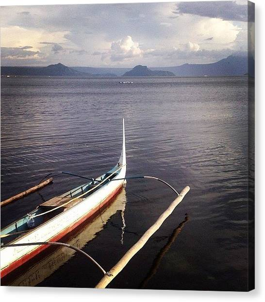 Volcanoes Canvas Print - Boat In The Water by Krystle Pagkalinawan