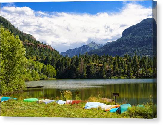 Boat Lined Lake Canvas Print