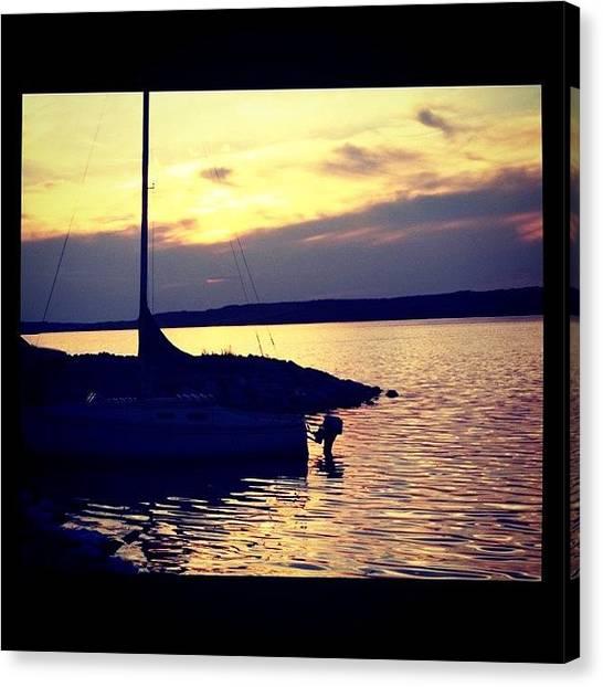 Saskatchewan Canvas Print - #boat #water #lake #sun #sunset #sky by Lacey Supple