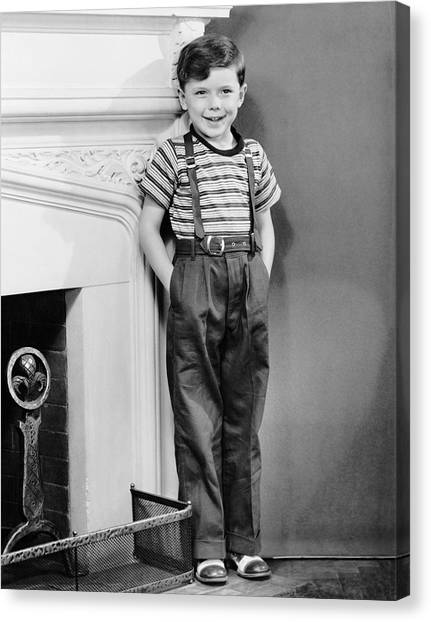 Boy Leaning Against Wall By Fireplace Canvas Print by George Marks