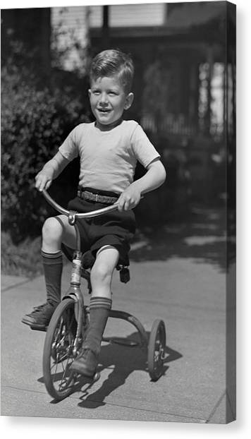 Boy On Tricycle Canvas Print by George Marks