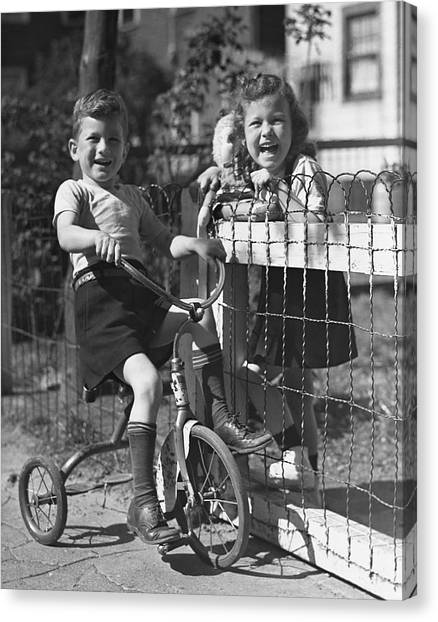 Boy On Tricycle W/ Girl Canvas Print by George Marks