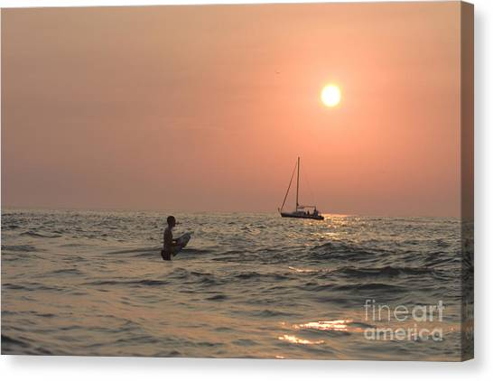 Bodyboard Canvas Print - Boy Swimming Near Sailboat At Sunset by Christopher Purcell