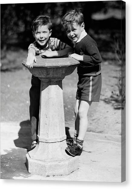 Boys At Drinking Fountain Canvas Print by George Marks