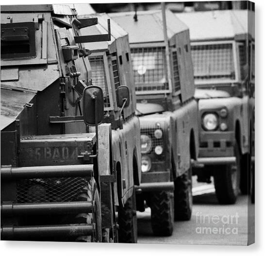 c5b8c5cd77 British Army And Ruc Vehicles Landrovers Belfast Northern Ireland Canvas  Print by Joe Fox