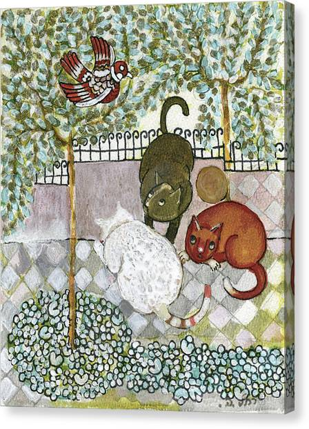 Brown And White Alley Cats Consider Catching A Bird In The Green Garden Canvas Print