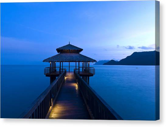 Building At The End Of A Jetty During Twilight Canvas Print