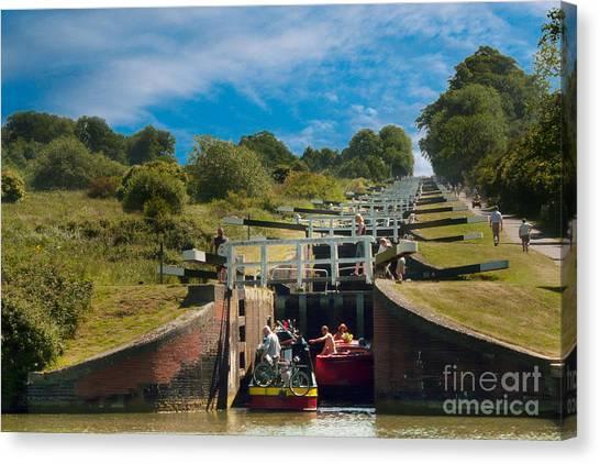 Caen Hill Locks Canvas Print by John Basford