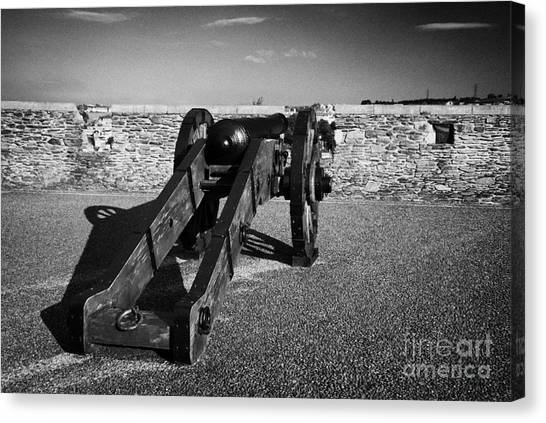 Cannon On Church Bastion Facing Out On The 17th Century Walls Of Derry Canvas Print by Joe Fox