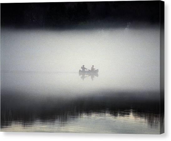 Canoe In Fog Canvas Print by Kurt Weiss