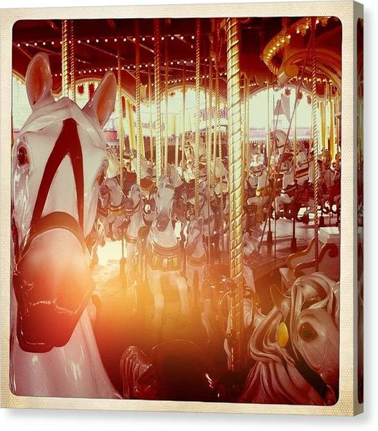 Race Horses Canvas Print - #carousel #whitehorse #merrygoround by James Roberts