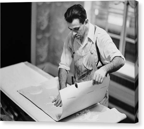 Carpenter Putting On Wallpaper Canvas Print by George Marks