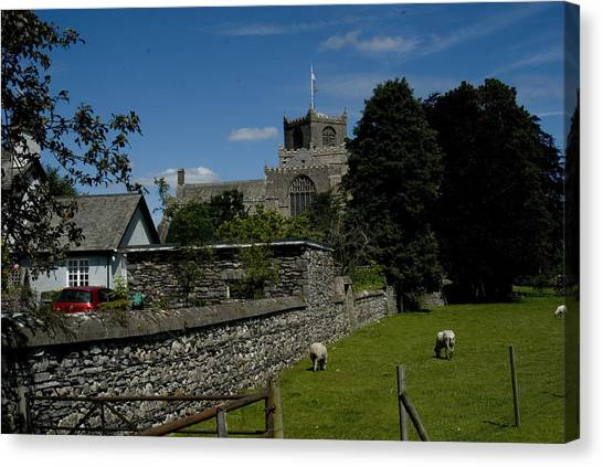 Cartmel Priory From The Causeway Canvas Print by Peter Jenkins