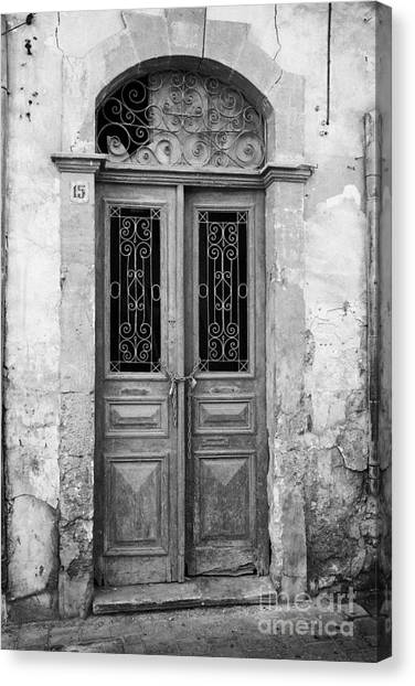 chained up wooden door to derelict house near the restricted area of the UN buffer zone Canvas Print by Joe Fox
