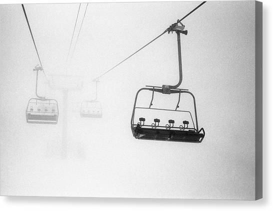 Chairlift In The Fog Canvas Print by Brian Caissie