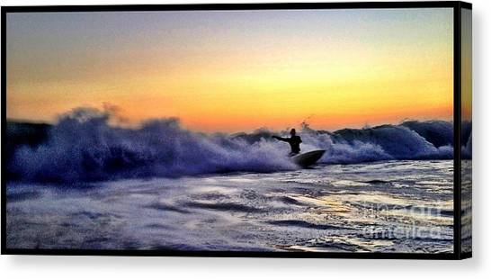 Chased By The Foam Canvas Print by Sebastian Acevedo