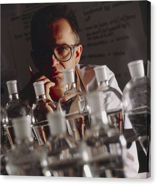 Chemist At Work In His Laboratory Canvas Print by Tek Image