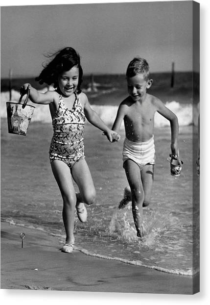 Children Playing At Seashore Canvas Print by George Marks