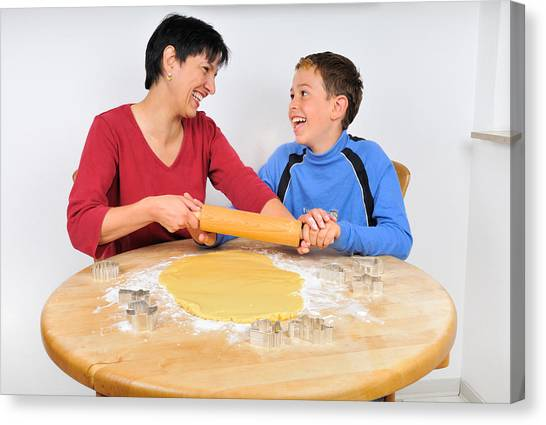 Christmas Baking - Mother And Son Laughing Canvas Print by Matthias Hauser
