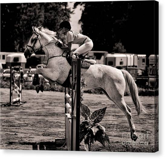 Clearing The Hurdle Canvas Print