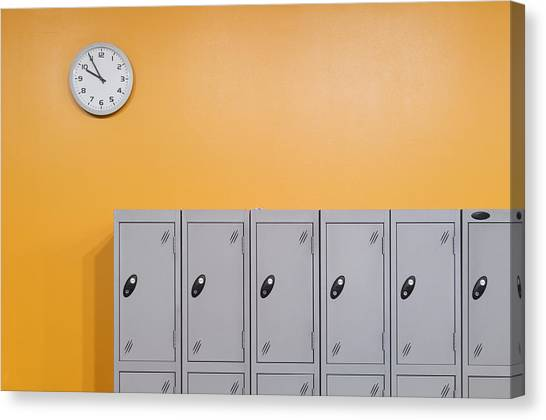 Orange Canvas Print - Clock On An Orange Wall Above Lockers by Iain  Sarjeant