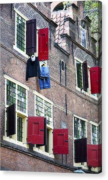 Clothes Hanging From A Window In Kattengat Canvas Print