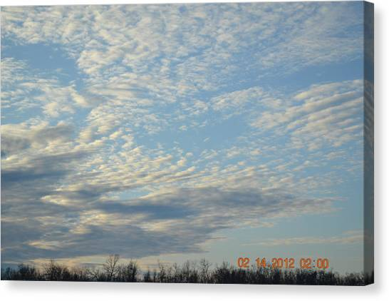 Clouds Before A Storm Canvas Print by Heidi Frye