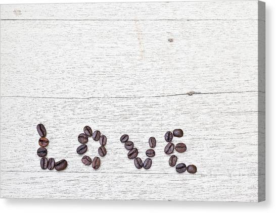 Coffee Beans And Word Of Love Canvas Print by Chavalit Kamolthamanon