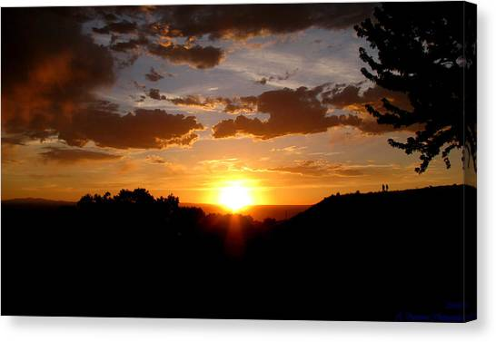 Colors Of A Setting Sun Canvas Print by Aaron Burrows