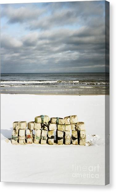 Concrete Bricks On A Snowy Beach Canvas Print
