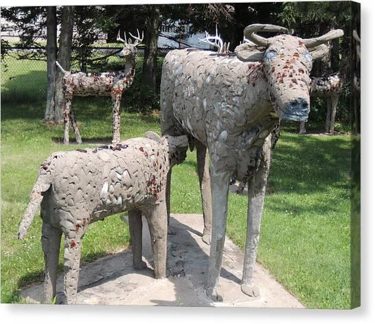 Concrete Calf And Cow Canvas Print by Peg Toliver