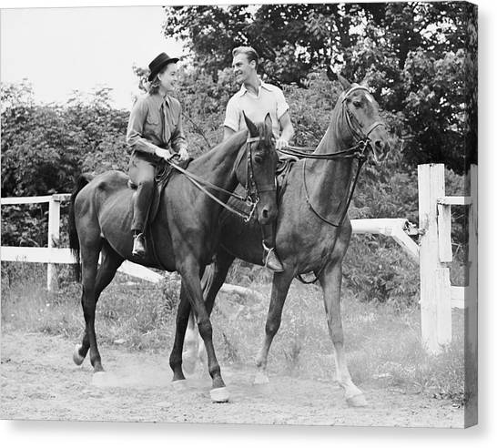 Couple Horseback Riding Canvas Print by George Marks