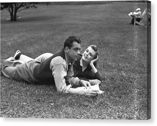 Couple Lying On Grass, (b&w) Canvas Print by George Marks
