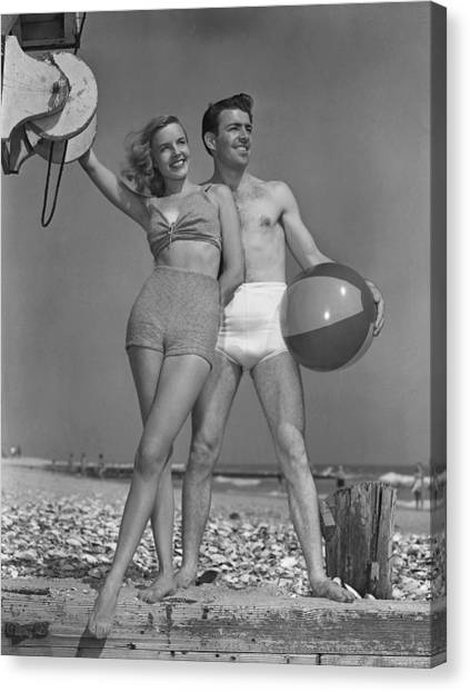 Couple On Beach W/beach Ball Canvas Print by George Marks