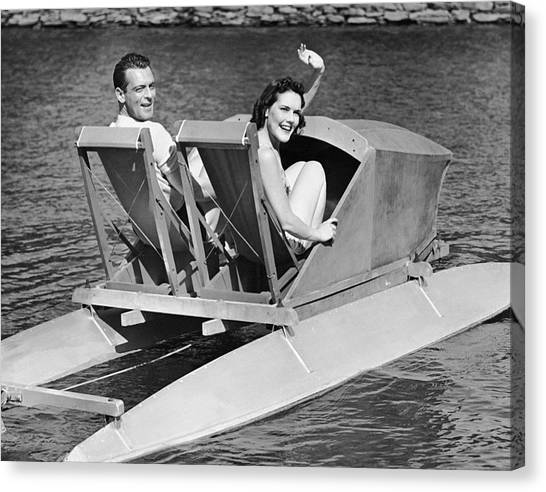 Couple On Lake In Paddle Boat Canvas Print by George Marks