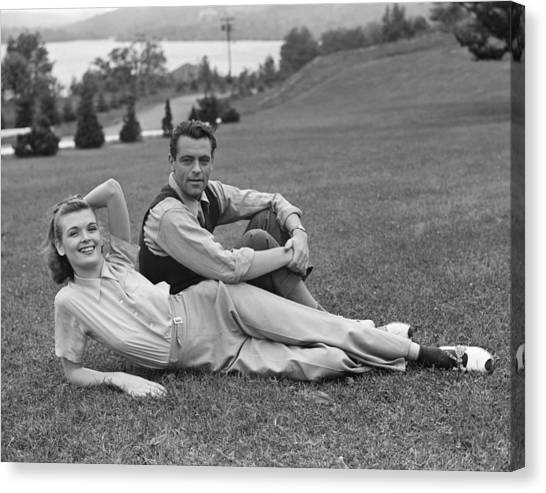 Couple On Lawn Canvas Print by George Marks