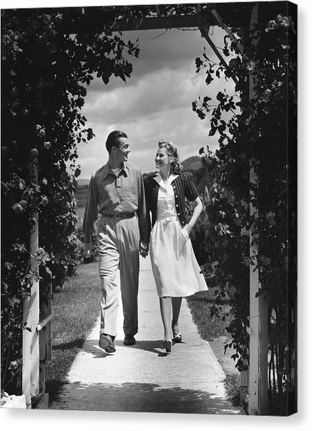 Couple Outdoors Holding Hands While Walking Canvas Print by George Marks