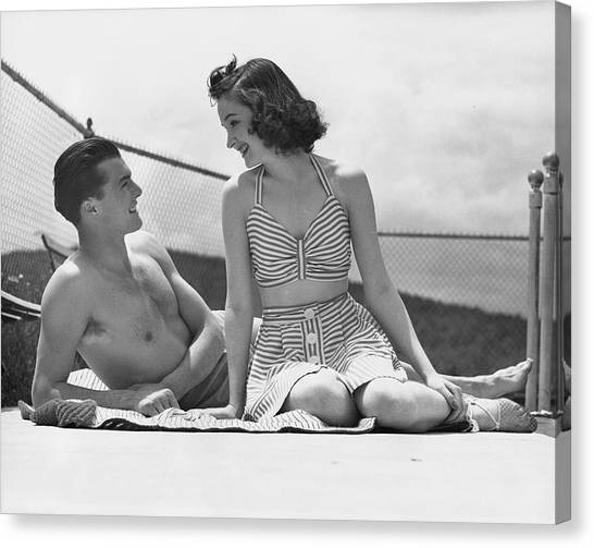 Couple Relaxing On A Sailboat Canvas Print by George Marks